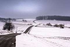 View of snow covered hills and fields in rural York County, Penn Royalty Free Stock Image
