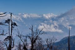 View of the snow-covered Himalayas from a height of 3250m royalty free stock image