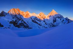 View of snow covered landscape with Dent Blanche mountains and Weisshorn mountain in the Swiss Alps near Zermatt. Panorama royalty free stock photo