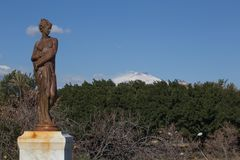 View of snow covered Mount Etna from Giardino Bellini in Catania. Sicily Royalty Free Stock Photo