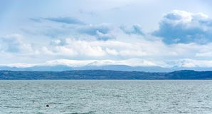 View of snow covered mountains of Snowdonia national park. From Moelfre in Anglesey Stock Photography