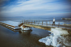 View of snow covered piers on frozen Blue sky Royalty Free Stock Image