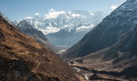View of snow covered range of Mount Manaslu and valley on the way to pass 8 156 meters with clouds in Himalayas, sunny day. At Manaslu Glacier in Gorkha stock photo