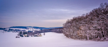 View of snow-covered rolling hills in rural York County, Pennsyl Stock Image