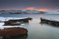 View of snow-covered shore with  boats Stock Images