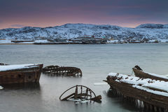 View of snow-covered shore with  boats Stock Photos