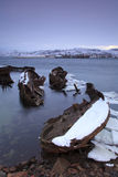 View of snow-covered shore with  boats Stock Photography