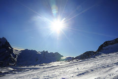View of snow mountains and ski slope in Switzerland Europe on a cold sunny day Royalty Free Stock Images
