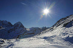 View of snow mountains and ski slope in Switzerland Europe on a cold sunny day Stock Photo