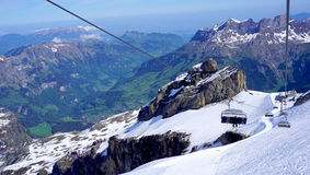 View of snow mountains titlis and cable car moving Royalty Free Stock Images