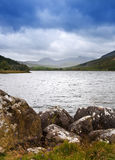 View of Snowdon from Llyn Mymbyr. View along Llyyn Mymbyr in Snowdonia National Park toowards cloud coovered Mount Snowdon Stock Photo