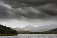 View of Snowdon from Llyn Mymbyr in Snowdonia. View along Llyyn Mymbyr in Snowdonia National Park toowards cloud coovered Mount Snowdon Stock Image