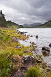 View of Snowdon from Llyn Mymbyr in Snowdonia. View along Llyyn Mymbyr in Snowdonia National Park toowards cloud coovered Mount Snowdon Stock Photos