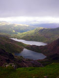 View from Snowdon peak - Wales. The view from the Snowdon peak in a cloudy day - Wales Royalty Free Stock Photography