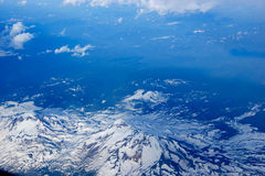 View of snowy mountains from an airplane Royalty Free Stock Photo