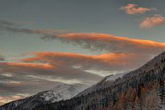 A View of Snowy Mountains Under Cloudy Sky royalty free stock photos