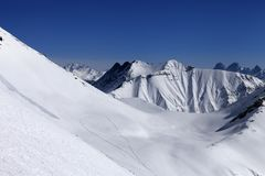 View on snowy off piste slope with trace from avalanche Royalty Free Stock Photos