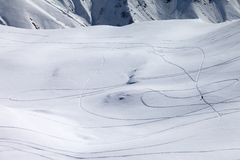 View on snowy off piste slope with trace from ski and snowboards Royalty Free Stock Images