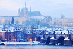 View on the snowy Prague gothic Castle with Charles Bridge, Czech Republic Royalty Free Stock Photo
