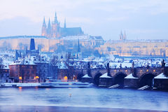 View on the snowy Prague gothic Castle with Charles Bridge, Czech Republic Stock Photography