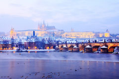 View on the snowy Prague gothic Castle with Charles Bridge after Sunset, Czech Republic Stock Photography