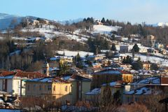 View of snowy urban. Town in Piedmont, Italy stock images