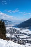 View at snowy village in Austrian mountains. Snowy village in the valley between Austrian mountains, Alpen Stock Images