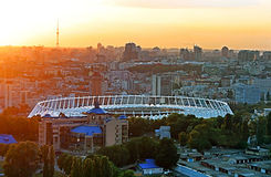 View of the soccer stadium at sunset and the view of Kyiv Royalty Free Stock Photos