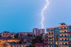 View of Sochi during thunderstorm, Russia. View of apartment buildings on the mountain with lightning during a morning thunderstorm, Sochi, Russia Royalty Free Stock Photography