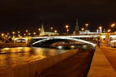 View of Sofiyskaya Embankment of Moskva river and Bolshoy Kamenny Bridge with night illumination. City landscape stock image