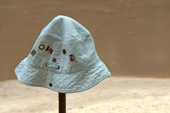 WHITE HAT ON A STICK. View of a soft white hat with Canadian flag badges pinned to it poised on a hiking stick Royalty Free Stock Photography