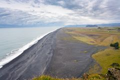 View Solheimafjara coastline from Dyrholaey cape. Travel to Iceland - above view of Solheimafjara coastline from Dyrholaey cape near Vik I Myrdal village on stock image