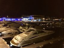 View of some boats at the marina in Sanxenxo, Galicia, Spain during night. In summer stock photography