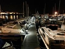 View of some boats at the marina in Sanxenxo Galicia Spain during night. In summer royalty free stock image