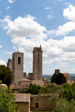View on some of famous towers in San Gimignano in Toscany in italy. On blue sky background Stock Photos