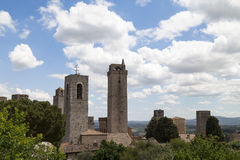 View on some of famous towers in San Gimignano in Toscany ,Italy. View on some of famous towers in San Gimignano in Toscany in Italy on blue sky background Stock Photos