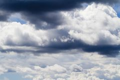 Stratocumulus clouds. View of some fluffy stratocumulus clouds on a blue sky Royalty Free Stock Images