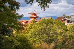 View of some iconic buildings at Kiyomizu-dera Buddhist Temple. With the main Pagoda structure in the middle -seen trough the autumn foliage at Mount Otowa in royalty free stock photos