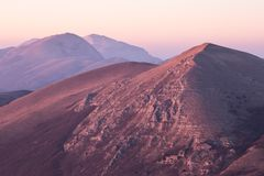A view of some mountains top, with beautiful, warm sunset colors.  Stock Images