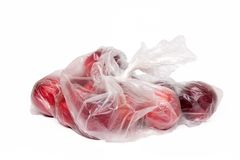 View of some plums inside a plastic bag. View of some plums inside a plastic bag isolated on a white background Stock Image