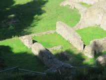 View of some Pompeii ruins. Pompeii, Italy - October 14, 2017: Ruins of Courtyards and walls in grassy fields royalty free stock photos