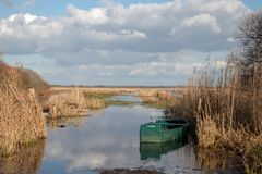 View of some salt marshes with an old abandoned boat royalty free stock images