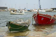 Anchored fishing boats. View of some traditional fishing boats anchored on the docks in Portugal royalty free stock images
