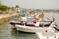 Traditional fishing boats. View of some traditional fishing boats anchored on a small fishing village royalty free stock photos