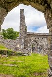 A view through a sone doorway of the abanoned ruins of Killone Abbey that was built in 1190 and sits on the banks of the Killone. Lake, just outside Ennis royalty free stock photos