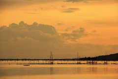 View of Songkhla lake which has fish cage in water ; Koh Yor, Sonkhla province, Thailand. View of Songkhla lake which has fish cage in water at sunset ; Koh Yor royalty free stock photo