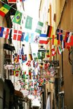 Flags of all Nations in Sorrento Italy town centre. A view of Sorrento town centre in Italy. Narrow street displays the flags of all Nations Royalty Free Stock Photography