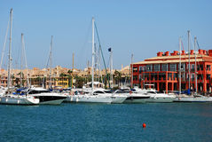 View of Sotogrande marina. Yachts and boats in the marina with buildings to the rear, Puerto Sotogrande, Cadiz Province, Andalucia, Spain, Western Europe Royalty Free Stock Photography