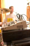 View on sound mixer board with drummer Stock Photography