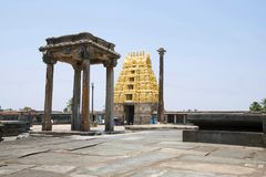 View of South East courtyard, Chennakeshava temple complex, Belur, Karnataka. The lamp post and East Gopuram is clearly seen. View of South East courtyard royalty free stock image